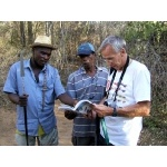 Tony consults with local birders. Photo by Rick Taylor. Copyright Borderland Tours. All rights reserved.